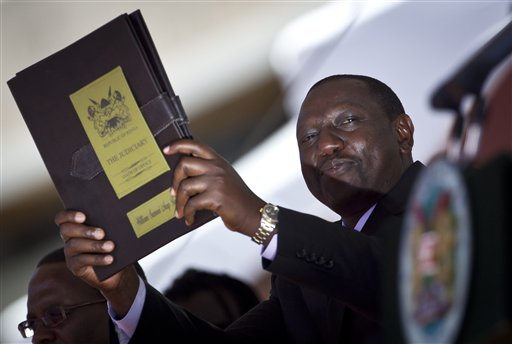 FILE - In this Tuesday, April 9, 2013 file photo, Kenya's Deputy President William Ruto swears the oath of office at the inauguration of himself and President Uhuru Kenyatta at Kasarani, near Nairobi in Kenya. The International Criminal Court has terminated the case against Kenya's deputy president William Ruto and ended his trial, saying there is insufficient evidence he was involved in deadly violence that erupted after his country's 2007 presidential elections.  The announcement  Tuesday April 5, 2016 marks the second time the court has had to admit defeat in its attempts to prosecute alleged ringleaders of the violence that left more than 1,000 people dead and forced 600,000 from their homes in Kenya.  (AP Photo/Ben Curtis, File)