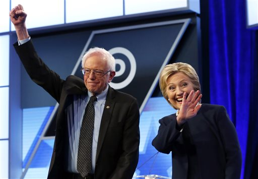 In this March 9, 2016, photo, Democratic presidential candidates, Hillary Clinton and Sen. Bernie Sanders, I-Vt.,  stand together before the start of the Univision, Washington Post Democratic presidential debate at Miami-Dade College in Miami. Clinton and her allies had hoped to switch much of their focus to the general election after Tuesday's primary contests, a plan thrown into doubt after her loss in Michigan last week. Wins on Tuesday would give Sanders fresh momentum in the contest, granting him months to continue criticizing Clinton's positions on issues that Republican frontrunner Donald Trump wants to put front and center in the general election. (AP Photo/Wilfredo Lee)